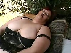 Elephant size woman playing with toy on nature great bbw