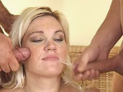 Pregnant blonde in stockings gets facial in orgy