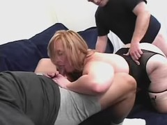 Big blonde makes sex with two dudes on sofa