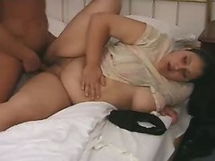Portly busty honey sucks and titfucks on bed great bbw