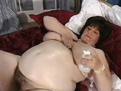 Big preggy mom with hairy pussy shows giant boobs