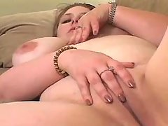 Elephant size woman playing with toy on sofa great bbw